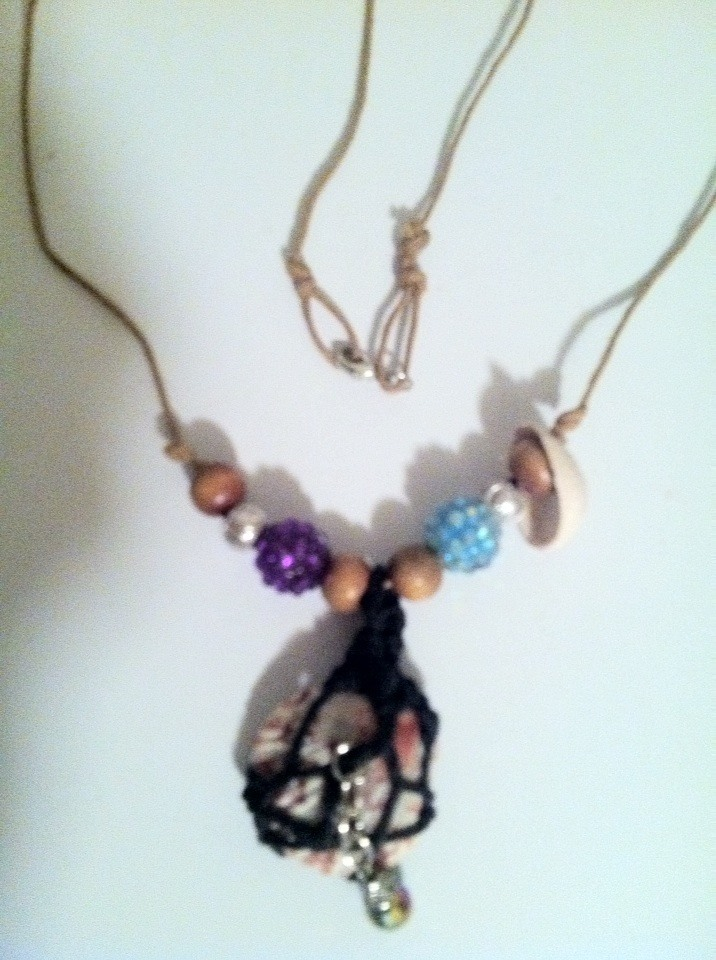 Crafty Faery witch handmade creation; sea shell pendant necklace( sea Faery sparkle ) hemp wrapped in black cord and tan hemp cord to wear, with faery glistening beads, and lil sea shell.... Magickal sea love